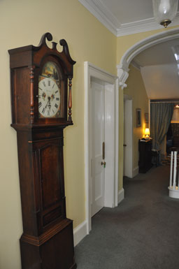 Grandfather clock in hall way